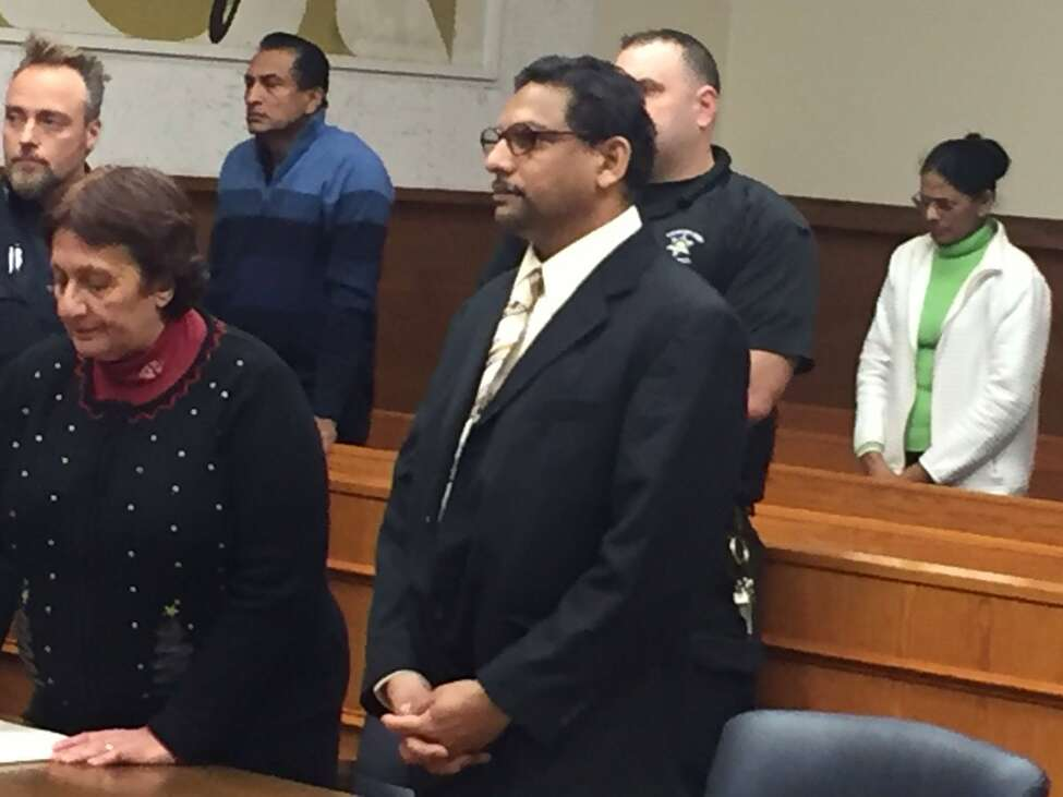 Tarchand Lall, right, and his attorney, Cheryl Coleman, stand in Schenectady County Court at the moment when a jury convicted him of first-degree murder for the killing of a man he orchestrated to collect $150,000 in insurance payments.