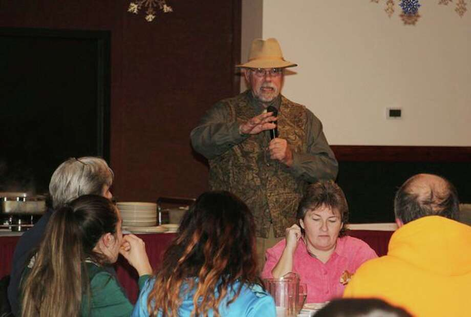 Guest speak Tom Lounsbury shared personal hunting stories with a crowd of about 100 hunters Tuesday night during the Greater Thumb Hunting Contest. The event was open to hunters in Huron, Sanilac and Tuscola counties for any deer harvested in those counties between archery and firearm season. By the end of the night, four people were named winners. (Bradley Massman/Huron Daily Tribune)