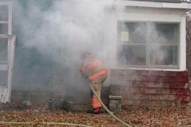 Firefighters from the Midland Fire Department perform a training exercise Wednesday, Dec. 12 at an empty house on West Carpenter St. (Mitchell Kukulka/mitchell.kukulka@mdn.net)