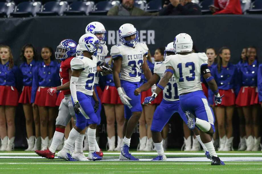 Cy Creek players congratulate linebacker Josh White (33) with his recovering of a West Brook fumble and then scoring a touchdown during the second quarter of the playoff game at NRG Stadium on Saturday, Dec. 8, 2018, in Houston. Photo: Yi-Chin Lee, Houston Chronicle / Staff Photographer / © 2018 Houston Chronicle