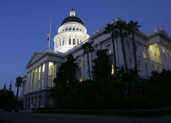 FILE -- In this Aug. 31, 2018 file photo, the lights of the Capitol dome shine as lawmakers work into the night on the last day of the 2017-2018 Legislative session, in Sacramento, Calif. California lawmakers begin their new legislative session Monday, Dec. 3, with crushing Democratic supermajorities in both legislative chambers to go with Democrats' sweep of all statewide offices. (AP Photo/Rich Pedroncelli, File)