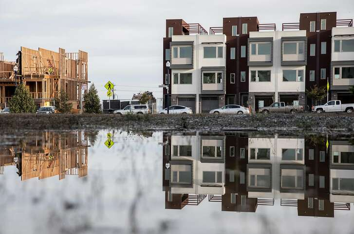 Construction workers continue building homes on Parcel A at the Hunters Point Naval Shipyard in the Hunters Point neighborhood of San Francisco, Calif. Wednesday, Nov. 28, 2018.