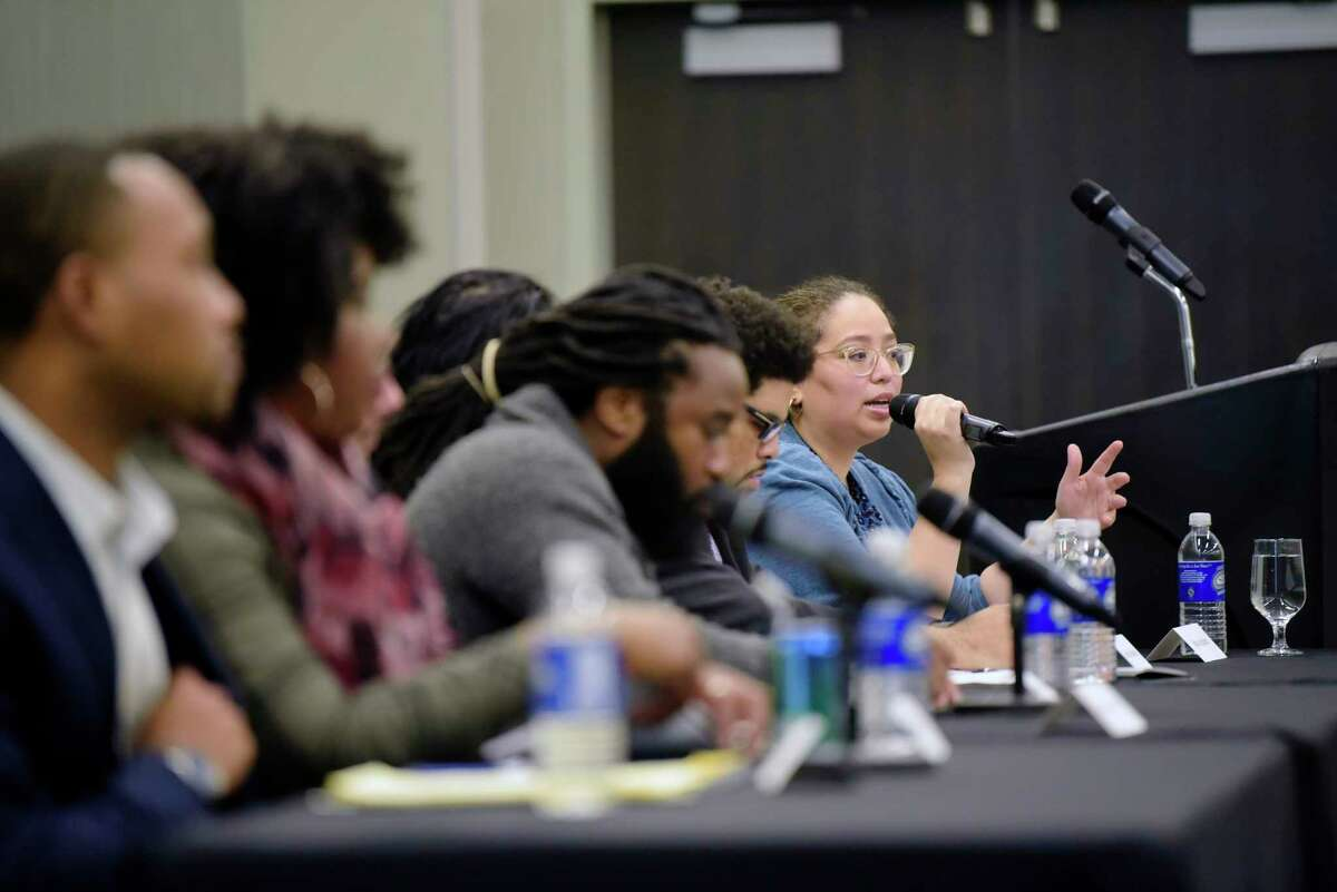 Alyssa Aguilera, far right, with VOCAL-NY moderates the panel discussion on Reparative Justice and Reparations at the Marijuana Justice Equity Reinvestment conference at the Albany Capital Center on Wednesday, Dec. 12, 2018, in Albany, N.Y. (Paul Buckowski/Times Union)