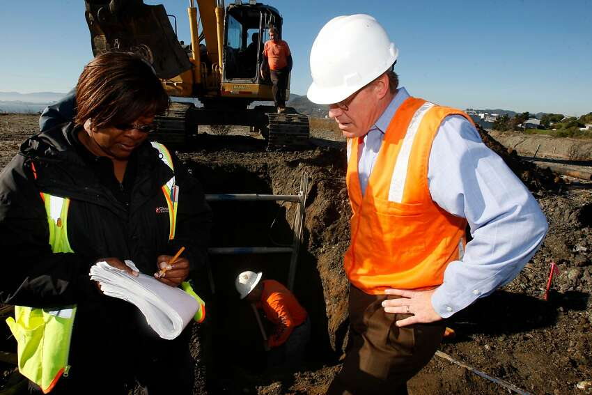 Carolyn Adkins (left), senior construction inspector, and Jeff Austin (right), project manager for the shipyard land where Lennar Corp. planned to build houses in 2009.