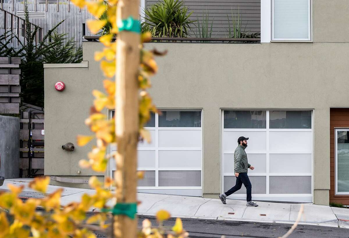 A man walks along the sidewalks of Parcel A in the Hunters Point Naval Shipyard in the Hunters Point neighborhood of San Francisco, Calif. Wednesday, Nov. 28, 2018.