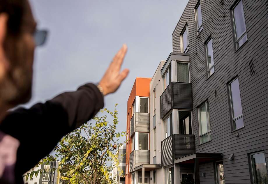Homeowner Michael Spencer explains the layout of his building on Parcel A at the shipyard development in San Francisco. Photo: Jessica Christian / The Chronicle