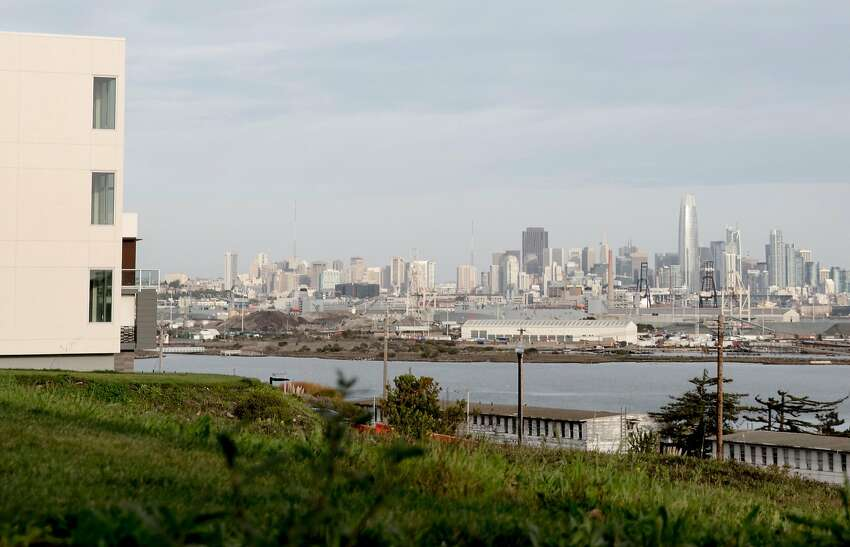 A newly constructed housing development on Parcel A looks out onto the San Francisco skyline in the former Navy shipyard.