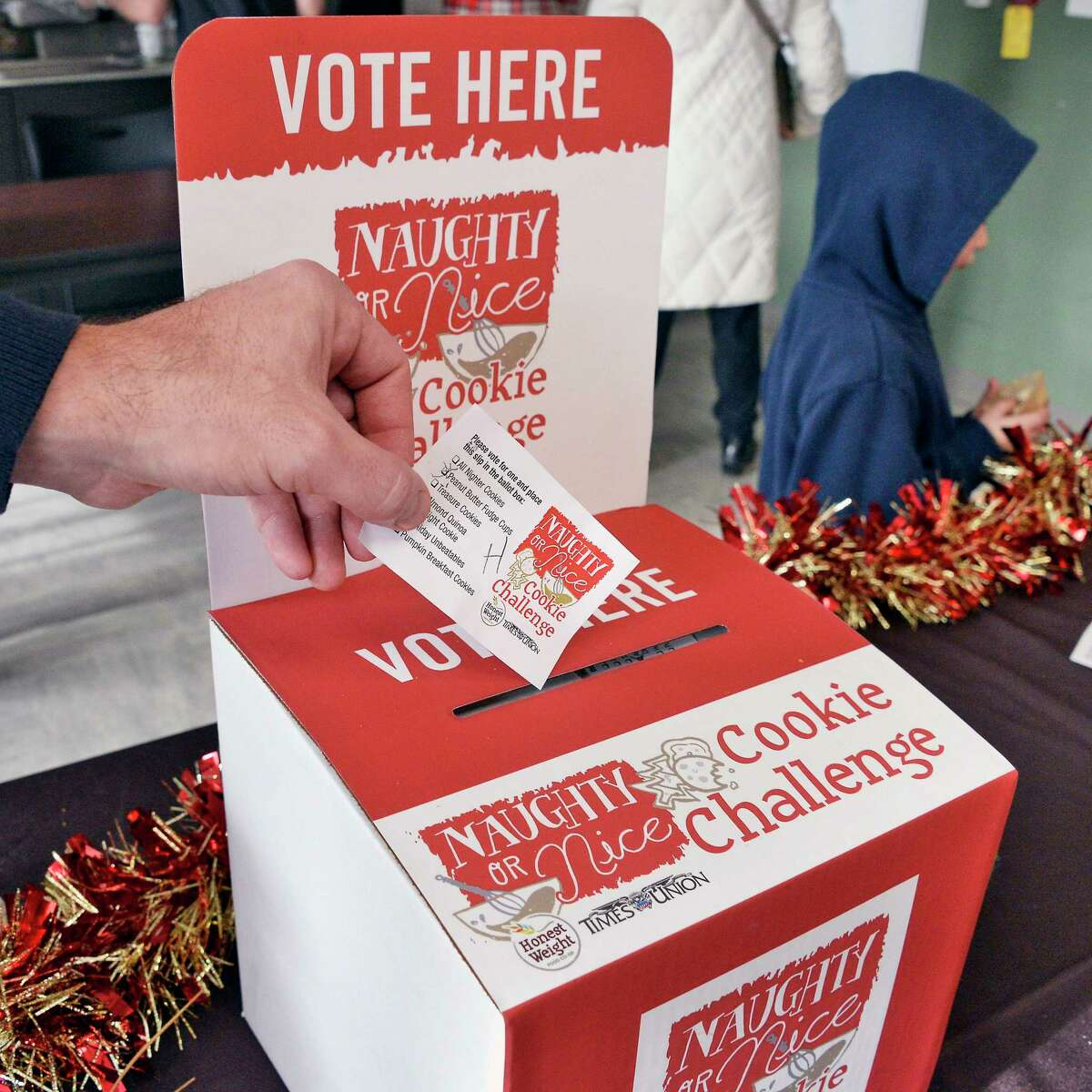 Participants cast their ballots during the Naughty or Nice Cookie Challenge at Honest Weight Food Co-op Saturday Dec. 1, 2018 in Albany, NY. (John Carl D'Annibale/Times Union)
