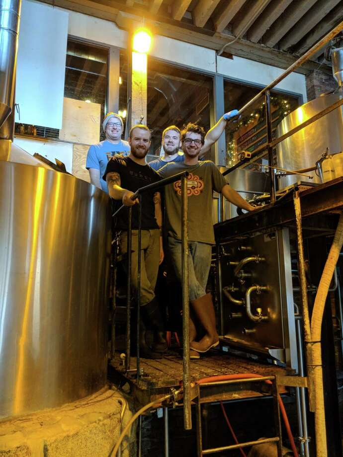 From left, Rare Form brewer Kevin Mullen, Brown's brewer Dan Cramer, Brown's brewer Lee MacCrea, and Rare Form brewer Zack Valenza brewing Resilience IPA at Brown's Troy Taproom. (Provided)