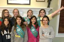 The holidays are a time of giving, and members of Shelton Girl Scout Troop #60443 put that motto into action with gifts and donations to children in need at Boys & Girls Village.
