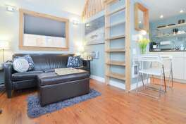 This one in Ballard has a private deck and hot tub, so why don't you just book it now?