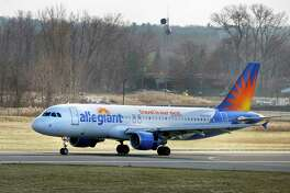 An Allegiant Air jetliner lands at Albany International Airport Wednesday Dec. 12, 2018 in Colonie, NY. (John Carl D'Annibale/Times Union)