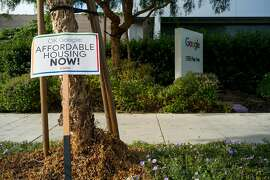 A sign for affordable housing is seen outside Google's headquarters in Mountain View, Calif. on Wednesday, June 6, 2018. Silicon Valley Rising is a community group that has raised concerns about Google's expansion into San Jose.