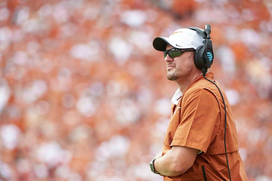 FILE - In this Oct. 6, 2018, file photo, Texas head coach Tom Herman looks on during the second half of an NCAA college football game against Oklahoma at the Cotton Bowl, Saturday,, in Dallas. Second-year coach Tom Herman promised in 2016 the Longhorns would again play for championships, but even he admitted Monday the program has taken a big leap faster than he expected when he took over after the 2016 season. The Longhorns face Oklahoma in the Big 12 championship game on Saturday. (AP Photo/Cooper Neill)