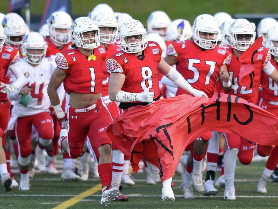 Greenwich's Jack Feda (8) leads the Cardinal Charge as they run onto the field prior to an FCIAC varsity football game against Fairfield Ludlowe at Cardinal Stadium on Thursday, Oct. 24, 2018 in Greenwich, Connecticut. Photo: Matthew Brown / Hearst Connecticut Media / Stamford Advocate