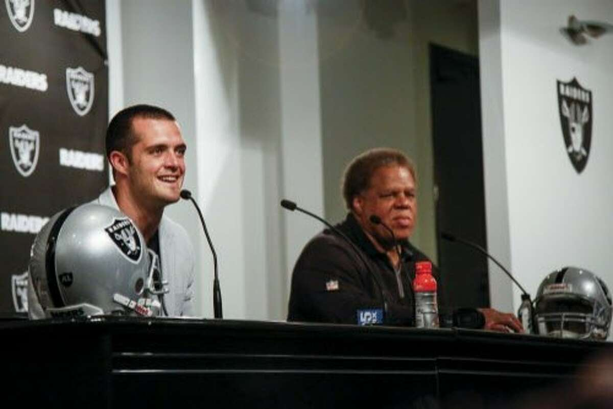 General Manager of the Oakland Raiders Reginald McKenzie, right, speaks at a press conference with Derek Carr, left, quarterback, about his $125 million dollar contract extension at the Oakland Raiders Facility in Oakland on Friday, June 23, 2017.