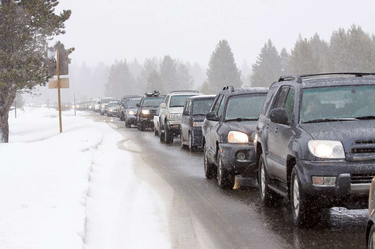 Gridlock traffic clogs a highway heading into South Lake Tahoe on a snowy day.