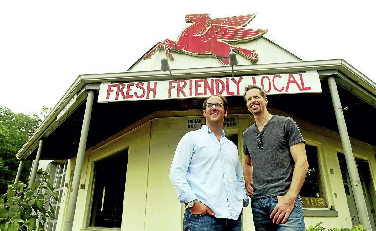 Greg Nobile, left, and Eamon Roche, co-owners of the The Stand, a former gas station and car repair shop turned into a roadside style barbecue restaurant on South Montowese Road in Branford. The unique restaurant is slated to close Dec. 23.