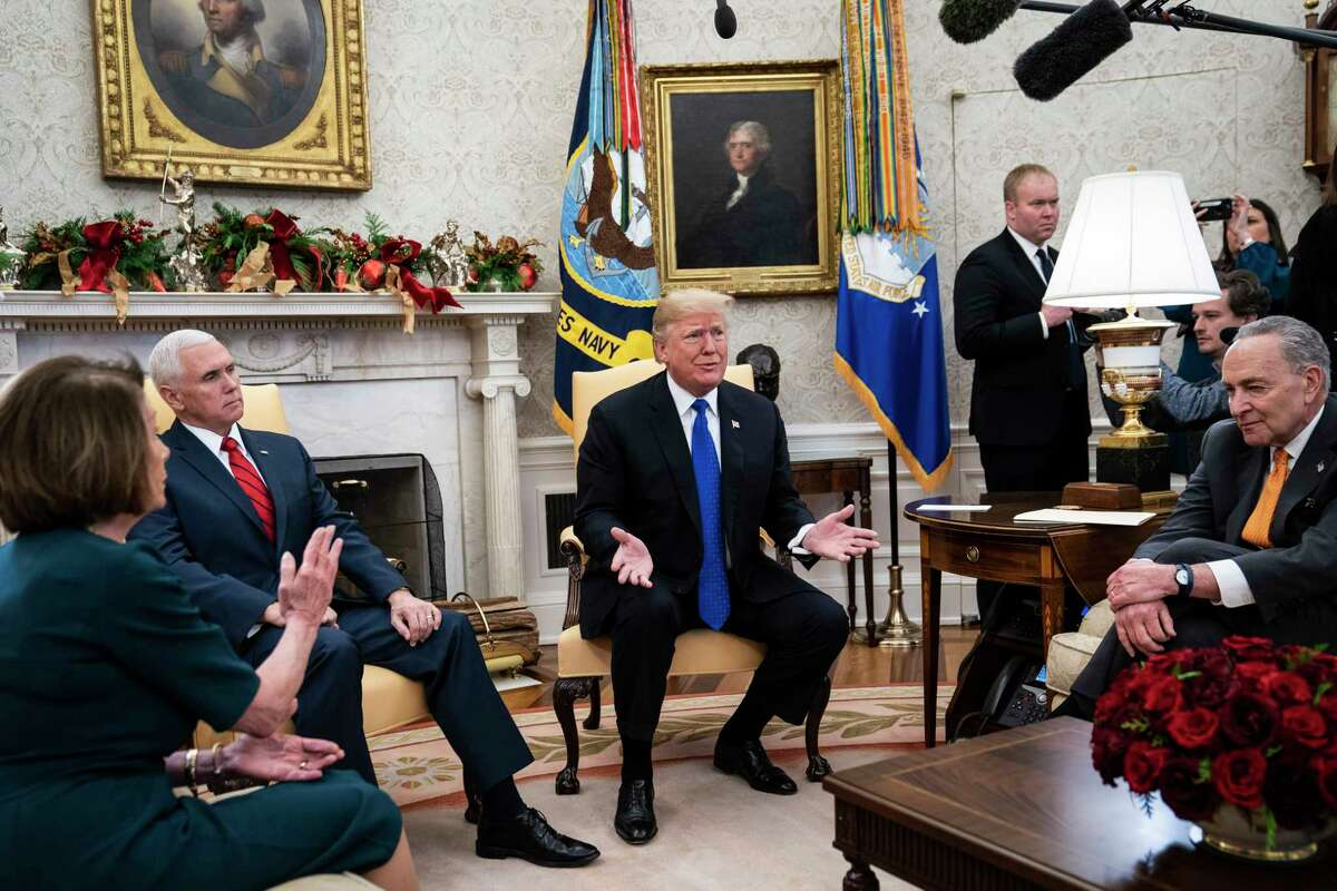President Trump debates with House Minority Leader Nancy Pelosi, D-Calif., left, and Senate Minority Leader Chuck Schumer, D-N.Y., right, as Vice President Mike Pence listens during a meeting in the Oval Office on Tuesday.