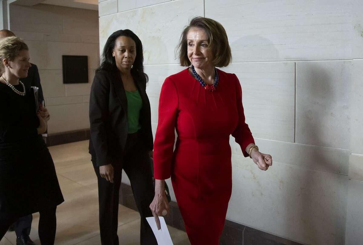 House Democratic Leader Nancy Pelosi walks past reporters at the Capitol on Dec. 12, 2018.