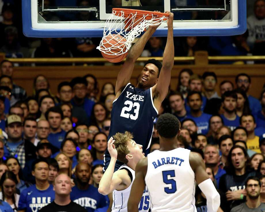 Yale's Jordan Bruner dunks over Duke's Alex O'Connell (15) and RJ Barrett (5) at Cameron Indoor Stadium on Dec. 8 in Durham, N.C. Photo: Lance King / Getty Images / 2018 Getty Images