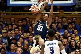 Yale's Jordan Bruner dunks over Duke's Alex O'Connell (15) and RJ Barrett (5) at Cameron Indoor Stadium on Dec. 8 in Durham, N.C.
