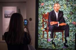 President Trump's portrait will join Barack Obama's at the National Portrait Gallery. What will his biography say? WASHINGTON, DC - FEBRUARY 20: Andi Kammerer takes a photo of the commissioned portrait of former President Barack Obama by Kehinde Wiley at the Smithsonian's National Portrait Gallery on February 20, 2018 in Washington, DC. (Photo by Carolyn Van Houten/The Washington Post via Getty Images)