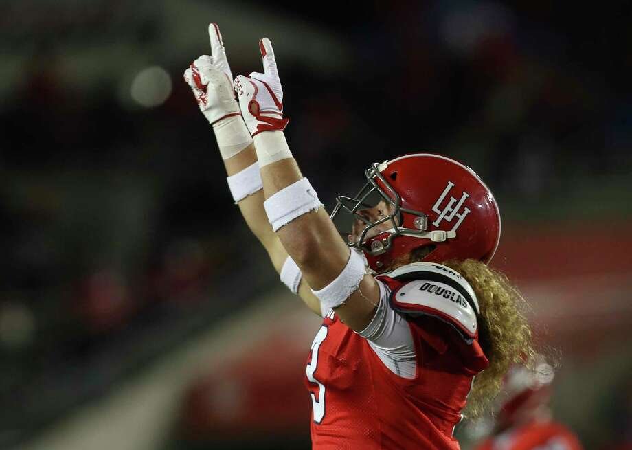 Houston Cougars defensive back Grant Stuard (3) celebrates bringing Temple Owls wide receiver Isaiah Wright (13) down during the second half of the game at TDECU Stadium on Saturday, Nov. 10, 2018, in Houston. Photo: Yi-Chin Lee, Houston Chronicle / Staff Photographer / © 2018 Houston Chronicle