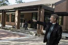 Rev. Gerry Sevick points out a courtyard area and explains some of the master plans for the at the Trinity Episcopal Church campus Tuesday, Dec. 11, 2018 at the Trinity Episcopal Church in The Woodlands. A new children?'s ministry building was recently completed on the campus.