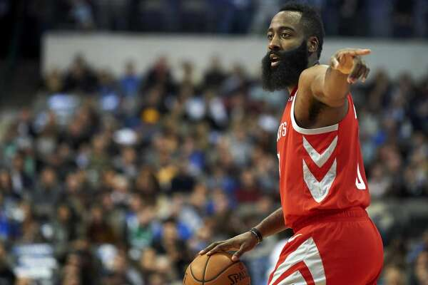 Houston Rockets guard James Harden (13) brings the ball up court against the Dallas Mavericks during the first half of an NBA basketball game, Saturday, Dec. 8, 2018, in Dallas. (AP Photo/Cooper Neill)