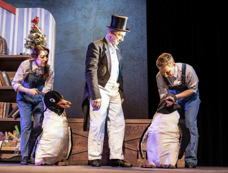 "Madeline Gutierrez, from left, Jon Gentry as Mr. Popper, and Caleb Craig perform with the penguin puppets built by props master Lucian Hernandez for ""Mr. Popper's Penguins"" at Magik Theatre."