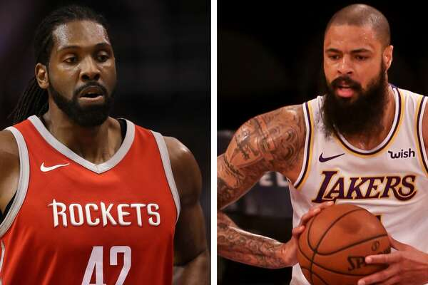 Houston Rockets center Nene and Los Angeles Lakers center Tyson Chandler.