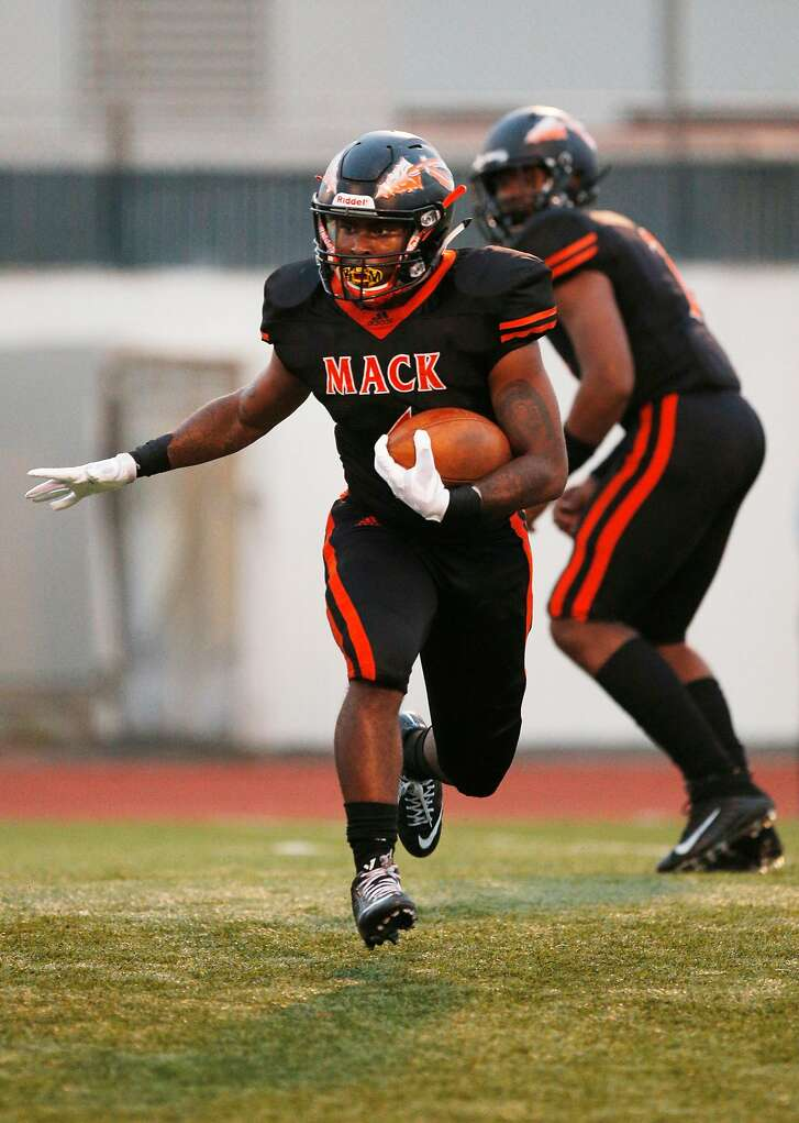 Warriors Adi Anderson (1) runs the ball during a high school football game between the McClymonds Warriors and Marin Catholic Wildcats at McClymonds High School on Friday, Aug. 24, 2018, in San Francisco, Calif.