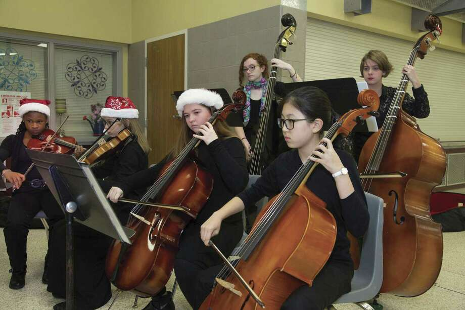 Young musicians with the Conroe Symphony Youth Orchestra perform prior to the Conroe Symphony Orchestra's Christmas