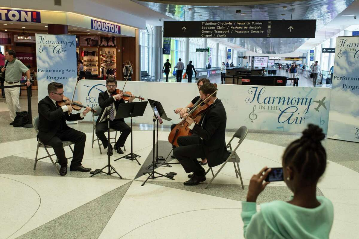 """Divisi Strings performs at Hobby Airport for the """"Harmony in the Air"""" program in 2015."""