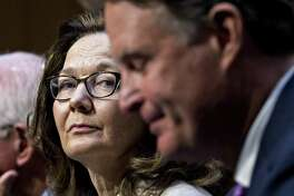 Gina Haspel, director of the Central Intelligence Agency nominee for President Donald Trump, listens while being introduced by former Senator Evan Bayh, D-Ind., right, during a Senate Intelligence Committee confirmation hearing in Washington on Wednesday, May 9, 2018.