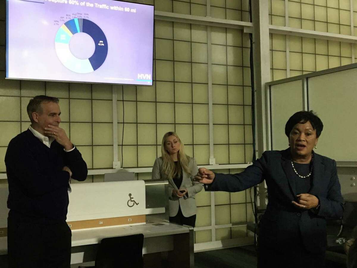 New Haven Mayor Toni Harp, right, speaks to the Tweed New Haven Airport Authority after a PowerPoint presentation by air service consultant Illona Cambron of ASM North America, center, Wednesday. At left is authority Chairman John Picard.