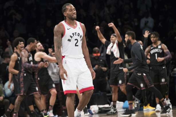 Toronto Raptors forward Kawhi Leonard (2) and the Brooklyn Nets react at the end of overtime of an NBA basketball game, Friday, Dec. 7, 2018, in New York. The Nets won 105-106. (AP Photo/Mary Altaffer)