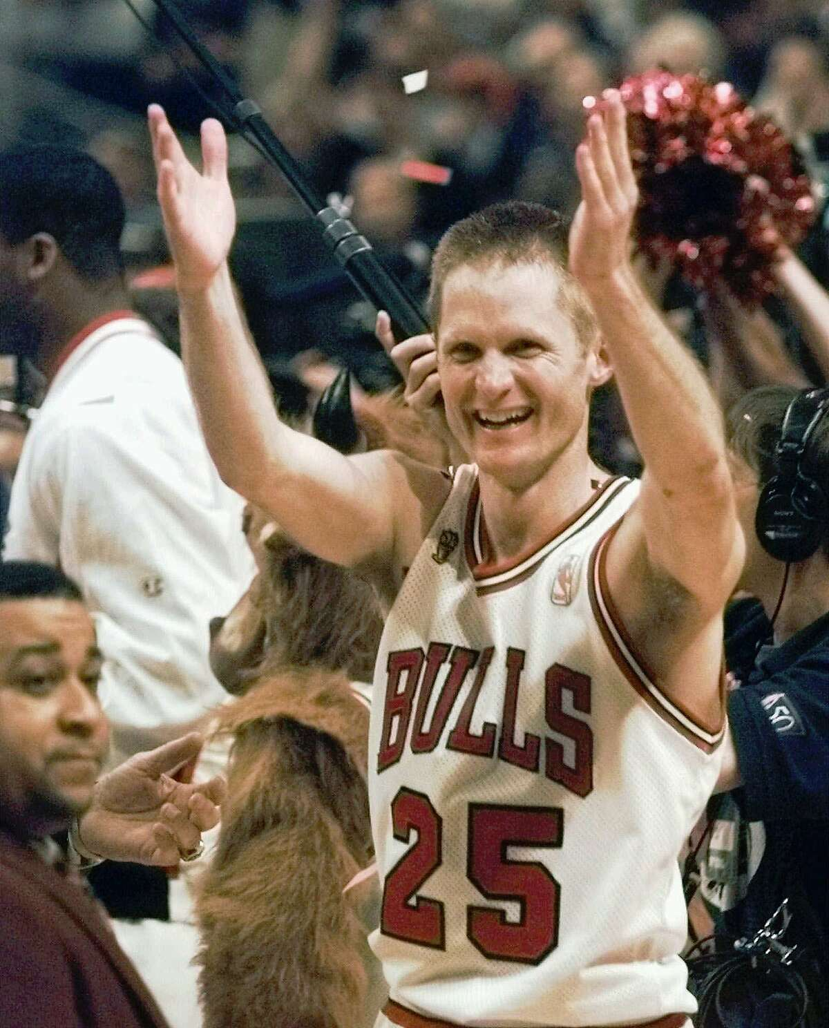 FILE--The Chicago Bulls' Steve Kerr celebrates after the Bulls beat the Utah Jazz 90-86 in Game 6 to win the NBA championship June 13, 1997, in Chicago. Kerr hit a shot with five seconds left that put the Bulls ahead for good in the game. Kerr will miss 6-8 weeks after fracturing his left collarbone when Philadelphia's Derrick Coleman landed on top of him. (AP Photo/Beth A. Keiser) HOUCHRON CAPTION (05/24/1998): Kerr