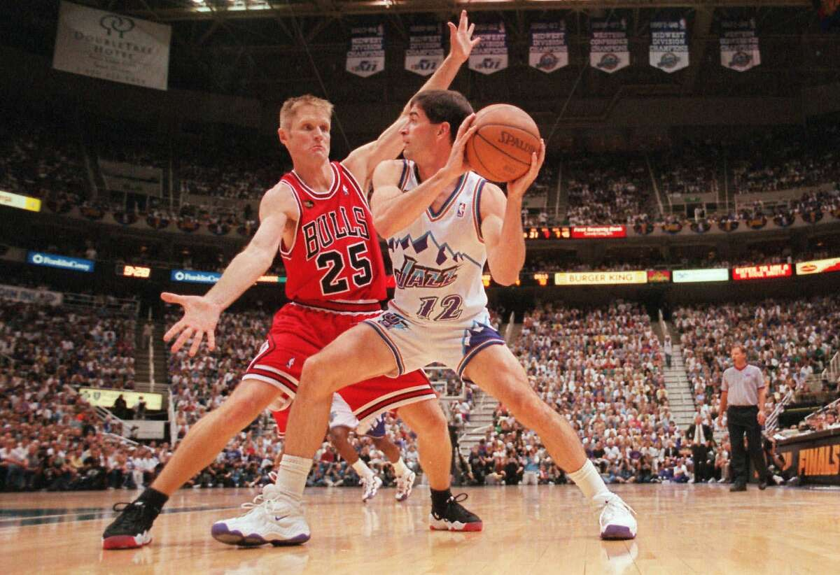Chicago Bulls' Steve Kerr (25) defends against Utah Jazz's John Stockton (12) in Game 1 of the NBA Finals in Salt Lake City, Wednesday, June 3, 1998. Stockton went on to score a team high 24 points and the Jazz defeated the Bulls 88-85 in overtime, taking a 1-0 lead in the best-of-seven series. (AP Photo/Mark J. Terrill)