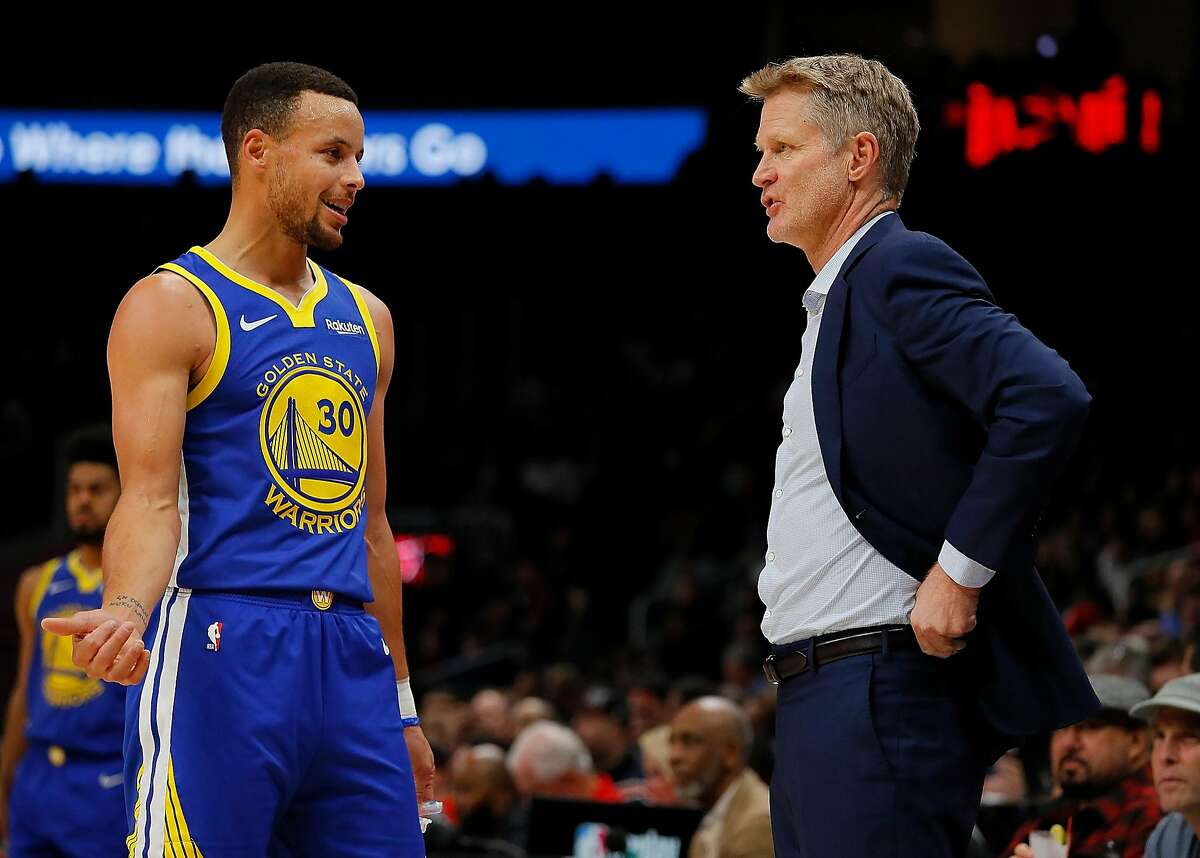 ATLANTA, GA - DECEMBER 03: Stephen Curry #30 and Steve Kerr of the Golden State Warriors converse against the Atlanta Hawks at State Farm Arena on December 3, 2018 in Atlanta, Georgia. NOTE TO USER: User expressly acknowledges and agrees that, by downloading and or using this photograph, User is consenting to the terms and conditions of the Getty Images License Agreement. (Photo by Kevin C. Cox/Getty Images)