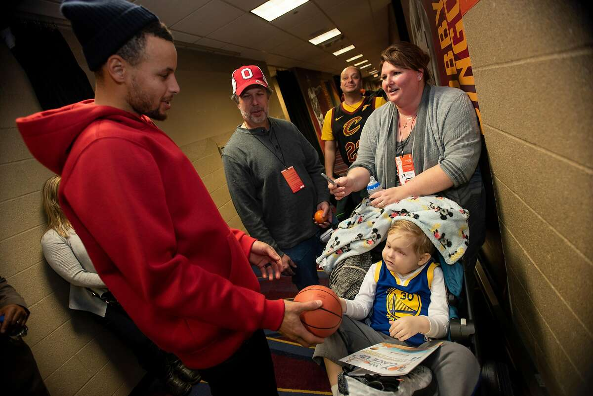 """Nathaniel, 4 of Cleveland who is a cancer patient meets his Hero Stephen Curry after Wednesday nights game as the Warriors face the Cavaliers at Quicken Loans Arena in Cleveland on December 5, 2018. """"A Special Wish Foundation"""" made this meeting possible for him to meet (Kyle Lanzer/Special to The San Francisco Chronicle)"""