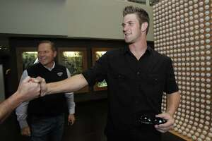 Baseball player Bryce Harper, right, shakes hands with a producer as his advisor Scott Boras watches after an interview in Newport Beach, Calif., Monday, June 7, 2010. The Washington Nationals selected junior college slugger Bryce Harper with the No. 1 overall pick in the baseball draft Monday night. (AP Photo/Jae C. Hong)