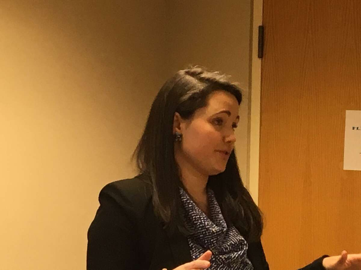 Karla Lindquist, economic development officer, speaks to the Development Commission about the city's food sector