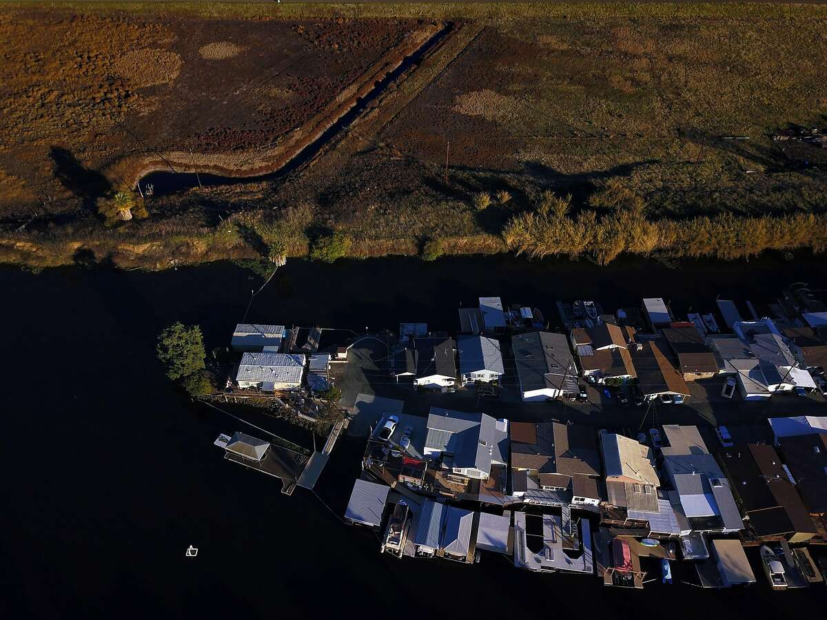 A group of homes with boat docks near Clear River Farm in the Sacramento-San Joaquin Delta outside Byron, Calif., on Tuesday, December 11, 2018. On Wednesday, the Legislature is expected to vote on a massive water bill which could decide the fate of the state's water, pitting environmentalists and sportsmen against farmers and city dwellers. No matter how the vote goes, someone will be unhappy, either the cities and suburbs, or the ranchers/farmers or the environmentalists.
