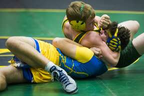 Midland's Hunter Nagel, bottom, and Dow's Brennan Doyle, top, wrestle one another during a meet on Wednesday, Dec. 12, 2018 at H. H. Dow High School. (Katy Kildee/kkildee@mdn.net)