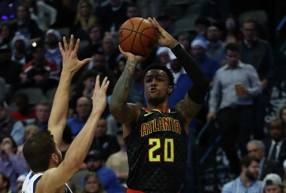 DALLAS, TEXAS - DECEMBER 12:  John Collins #20 of the Atlanta Hawks takes a shot against Maximilian Kleber #42 of the Dallas Mavericks in the first half at American Airlines Center on December 12, 2018 in Dallas, Texas.  NOTE TO USER: User expressly acknowledges and agrees that, by downloading and or using this photograph, User is consenting to the terms and conditions of the Getty Images License Agreement. (Photo by Ronald Martinez/Getty Images) Photo: Ronald Martinez / 2018 Getty Images