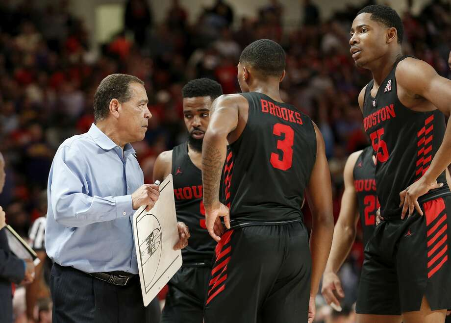PHOTOS: Houston vs. East Carolina  Houston Cougars head coach Kelvin Sampson calls a play during a timeout during the second half of the NCAA basketball game between the Houston Cougars and the LSU Tigers at the Fertitta Center in Houston, TX on Wednesday, December 12, 2018.  Houston defeated LSU 82-76. >>>See game action from Houston's rout of East Carolina on Wednesday ...  Photo: Tim Warner/Contributor