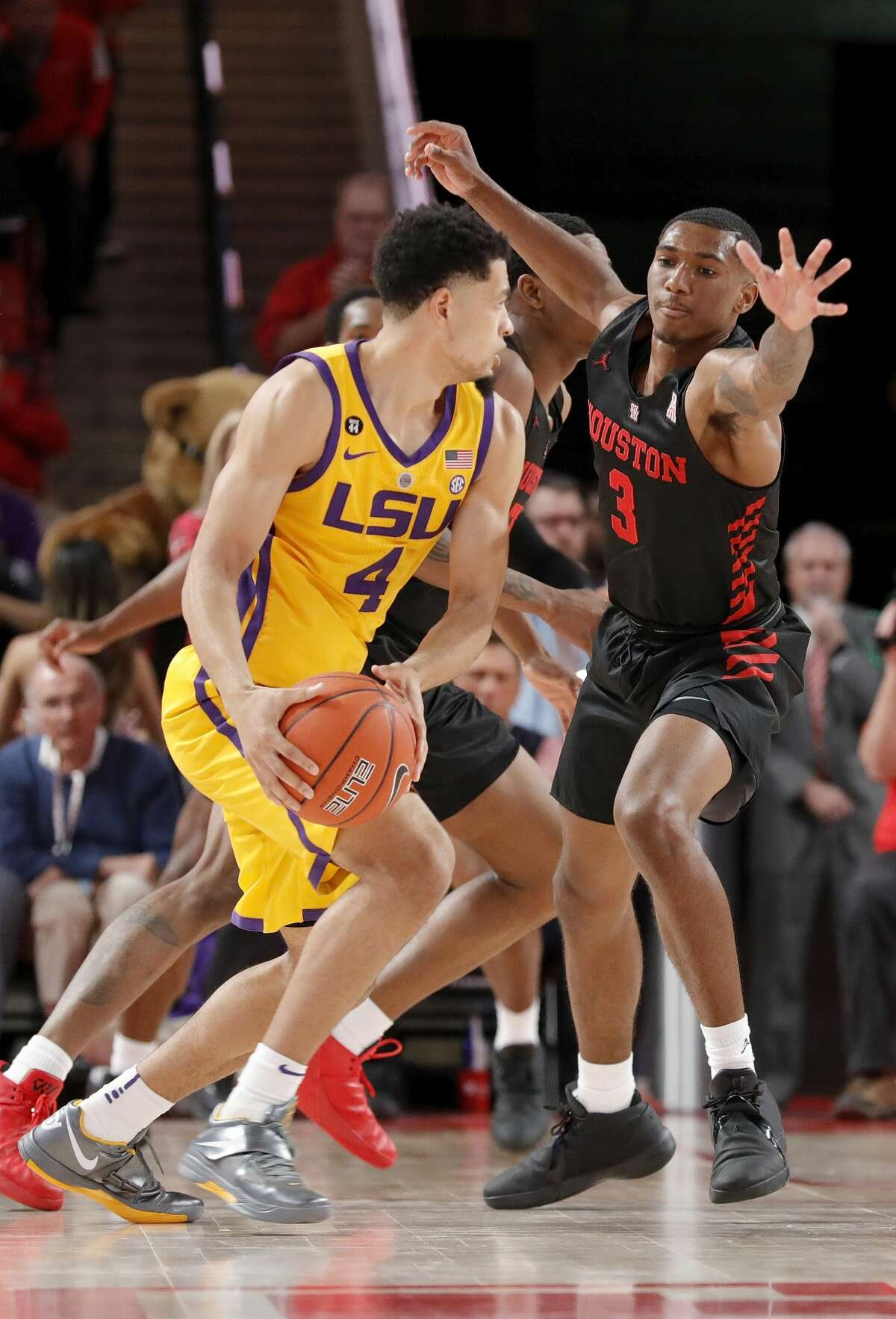 Houston Cougars guard Armoni Brooks (3) defends LSU Tigers guard Skylar Mays (4) during the second half of the NCAA basketball game between the Houston Cougars and the LSU Tigers at the Fertitta Center in Houston, TX on Wednesday, December 12, 2018. Houston defeated LSU 82-76.