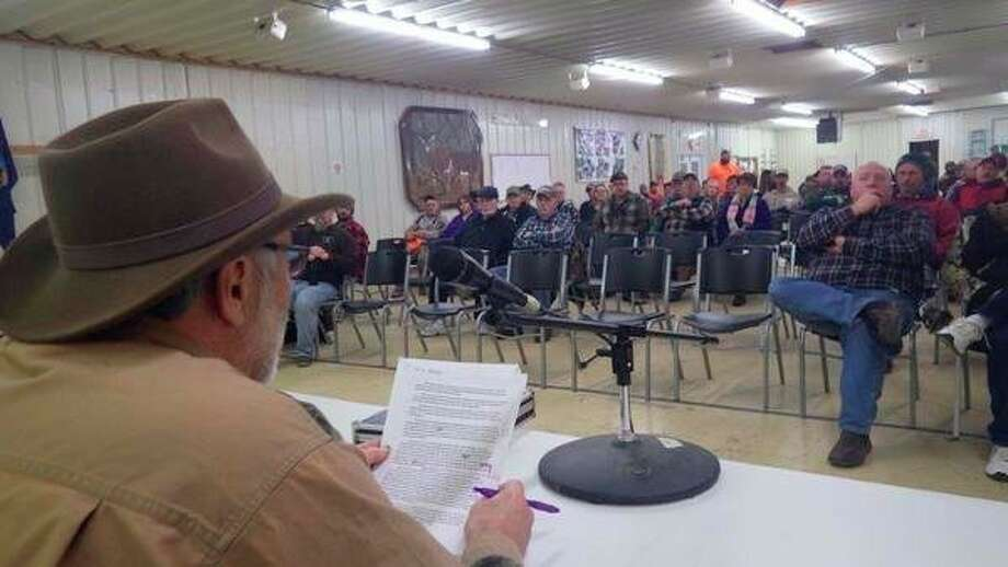 Above, United Sportsmen's Alliance representative Bob Walker, of Kingston, addresses a large gathering of Lapeer County residents at the Lapeer County Sportsmen's Club last week, during a meeting about the Mandatory Antler Point Restrictions proposal for the Thumb. At right, This billboard located near Cass City, in support of a Mandatory Antler Point Restriction proposal for the Thumb, asks people to 'vote yes,' when it actually isn't a vote at all, but is a sample survey instead. (Tom Lounsbury/Hearst Michigan)